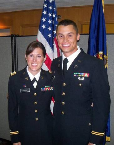 Drs. Rory and Jessica Sharp in their military uniform giving their best smile