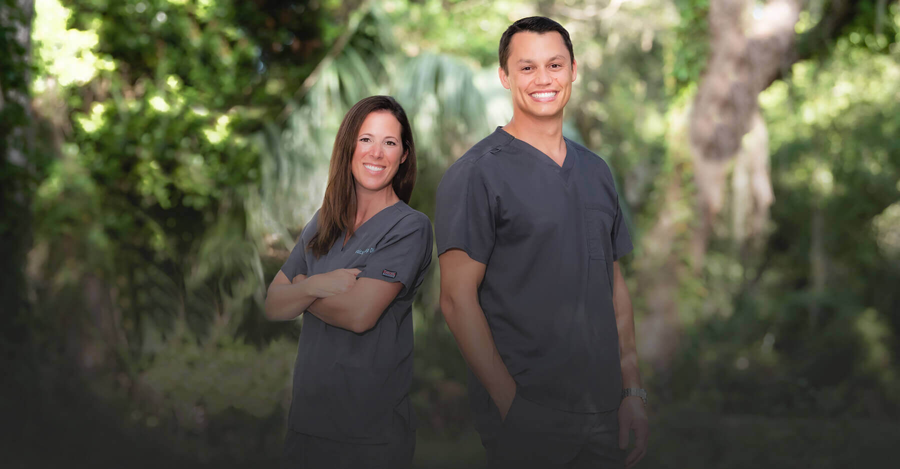 Your friendly dentists in St. Marys, GA standing next to each other